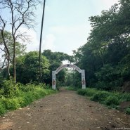 An archway showing the way up to the ashram; its not 8km from here like the board says
