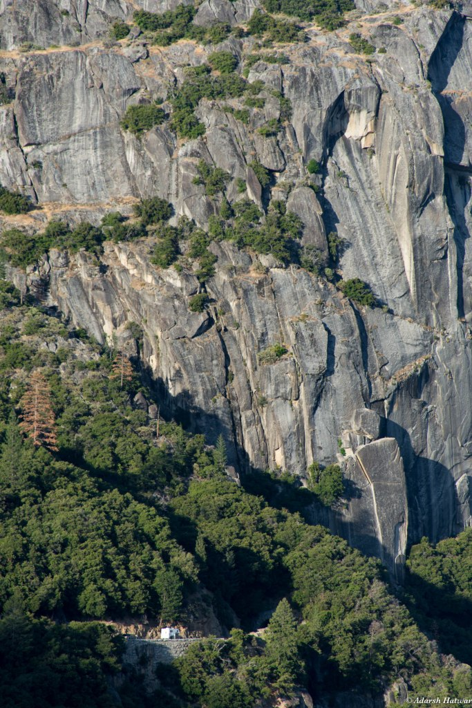 Sheer granite cliffs, bigger than you'll ever see. Look at the vehicles at the bottom for scale